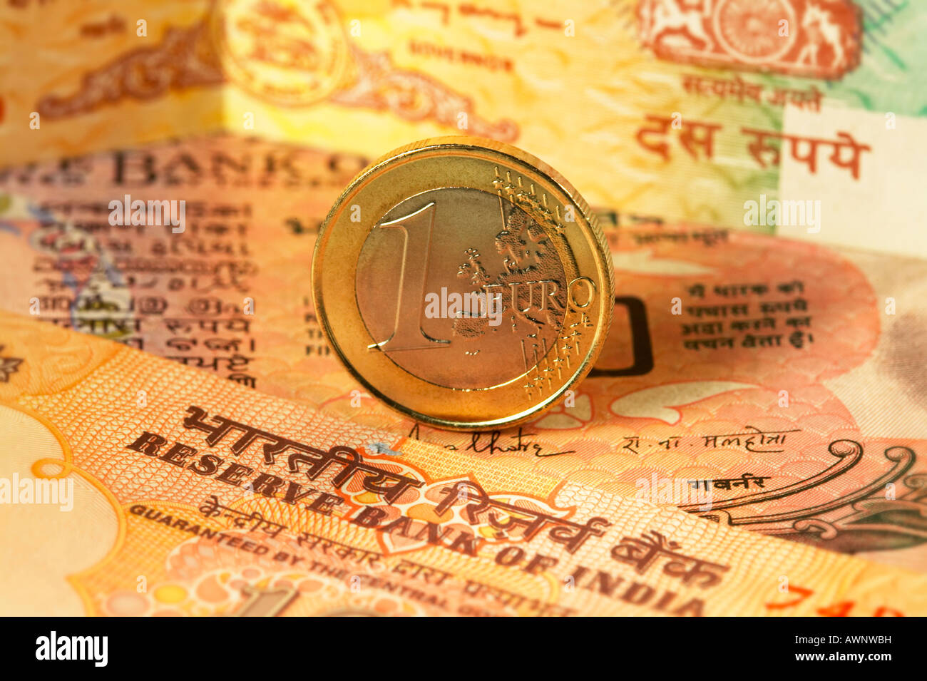 Euro Coin Indian Rupee Bank notes close up - Stock Image