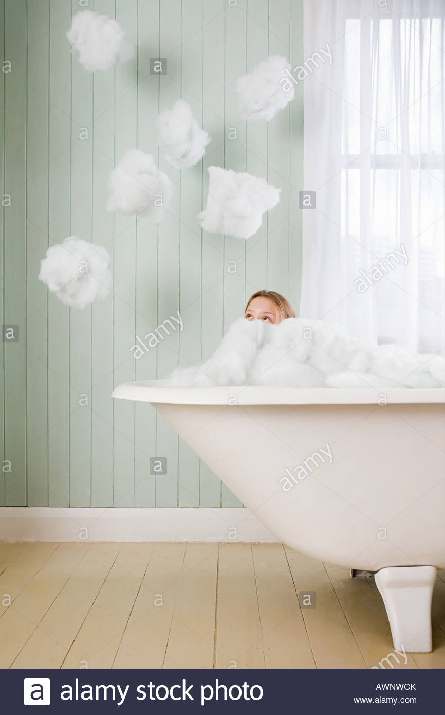 A girl in a bath - Stock Image