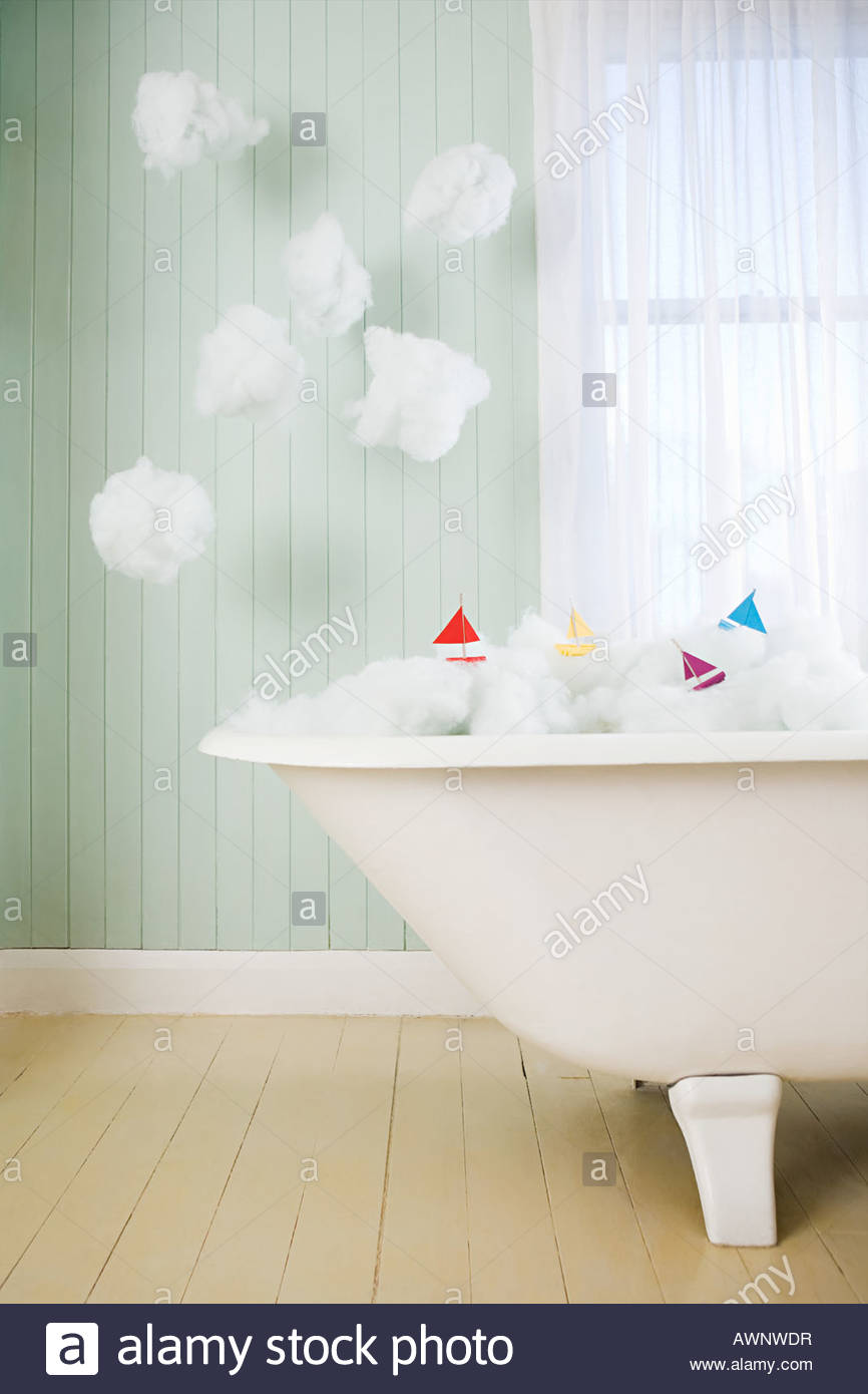 Boats on waves in a bath - Stock Image