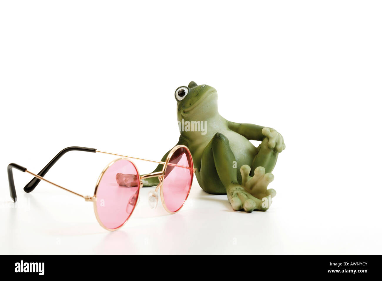 Frog and rose-coloured glasses Stock Photo