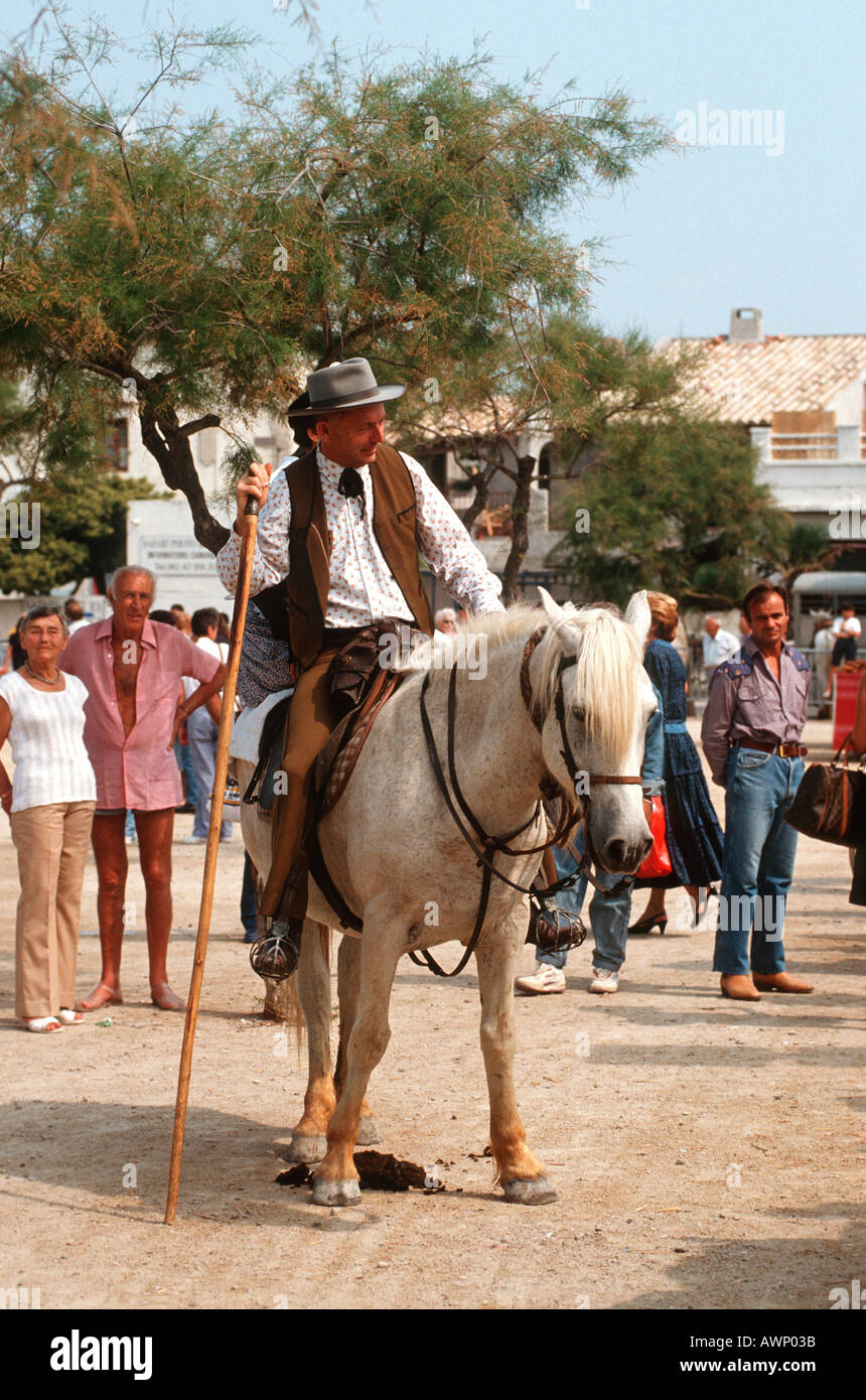 1e58f48ad94 Camargue Guardian Cowboy with wife in tradional dress at Festival of Santes  Maries de la Mere
