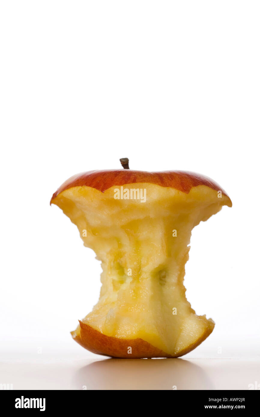 Apple core on a table - Stock Image