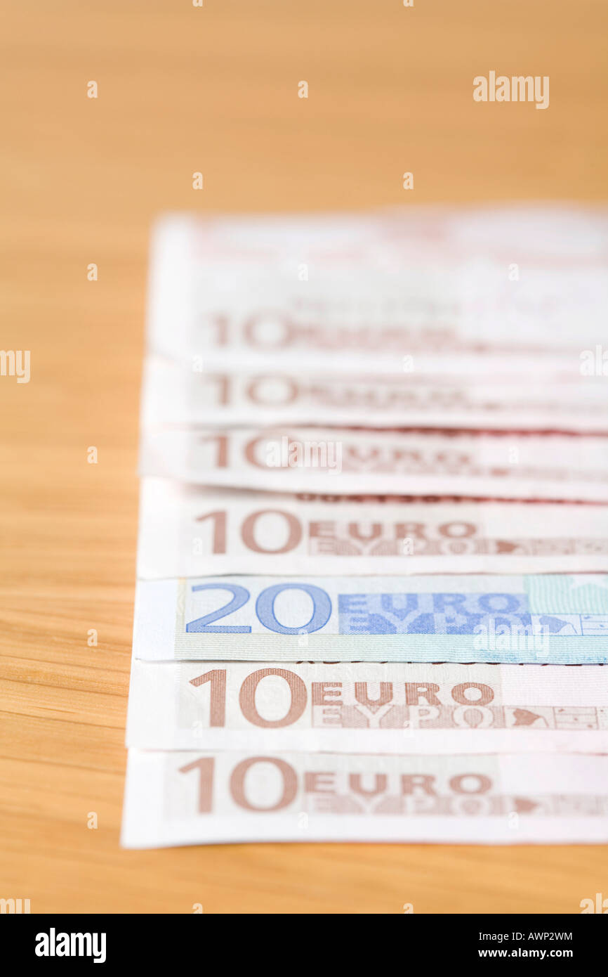 Euro bills laid out in a row - Stock Image