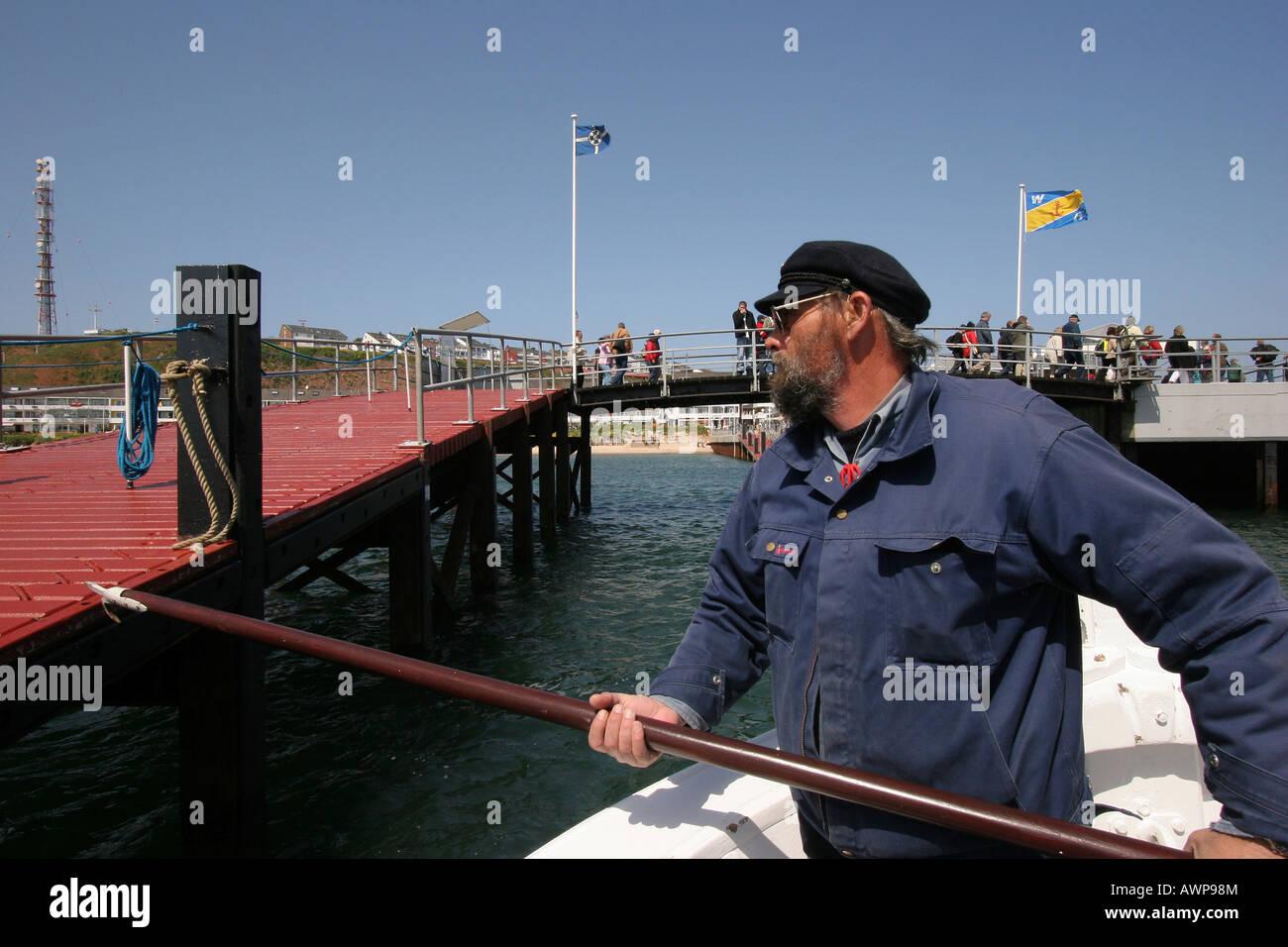 Boerte boat captain docking on deep-sea island Heligoland, Schleswig-Holstein, Germany, Europe - Stock Image