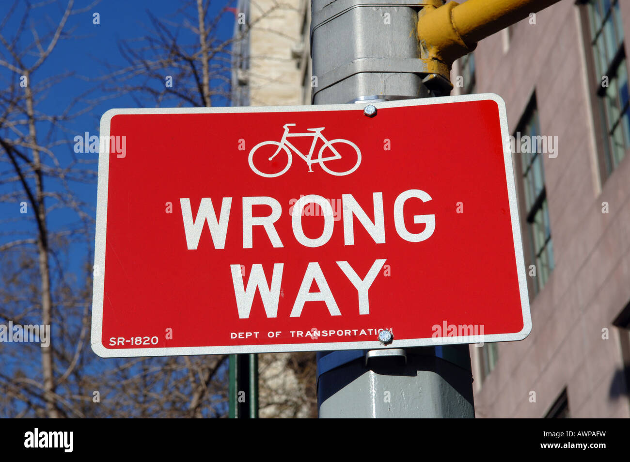 Wrong way sign on the new bikeway on Ninth Avenue in the NYC neighborhood of Chelsea - Stock Image