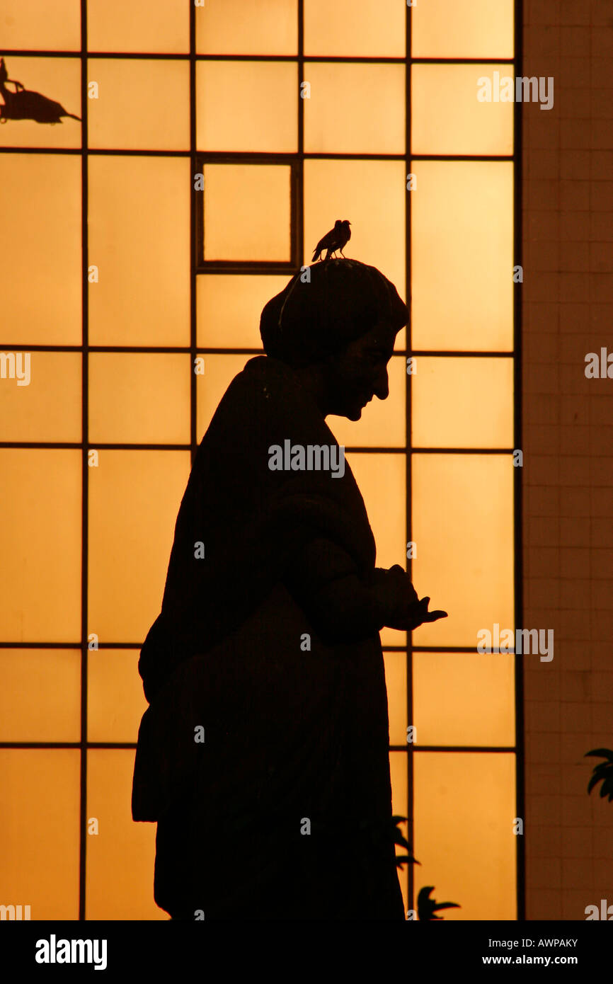 Statue of Indira Gandhi silhouetted in the evening light, Kolkata, West Bengal, India, Asia - Stock Image