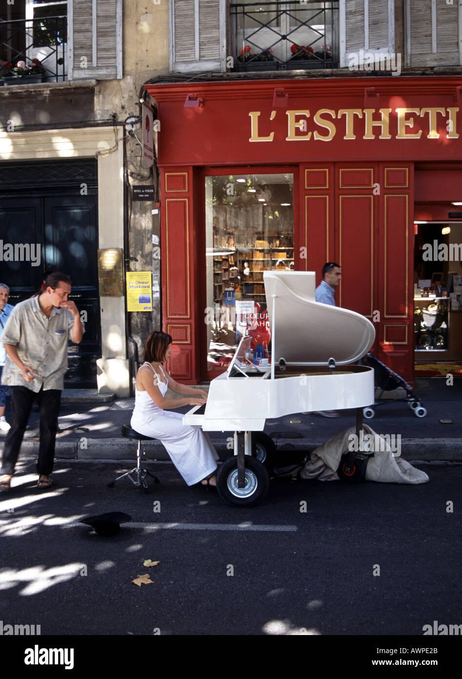 Piano recital in the market Aix en Provence - Stock Image