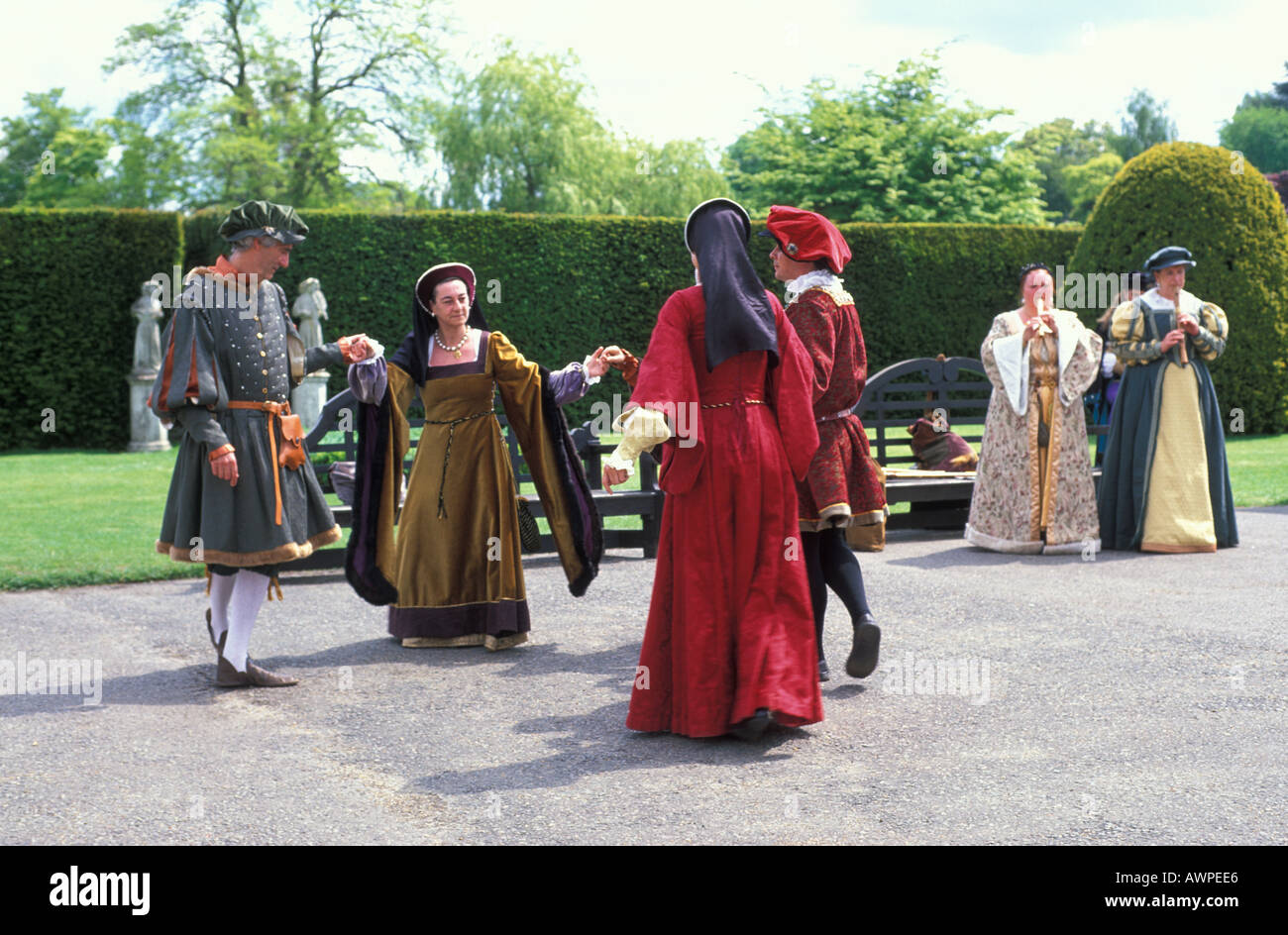 Elizabethan dancing in traditional costumes in Hever Castle Kent England - Stock Image