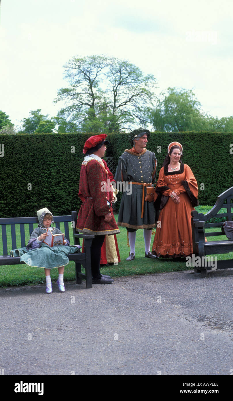 People dressed up in Elizabethan costumes in Hever Castle Kent England - Stock Image