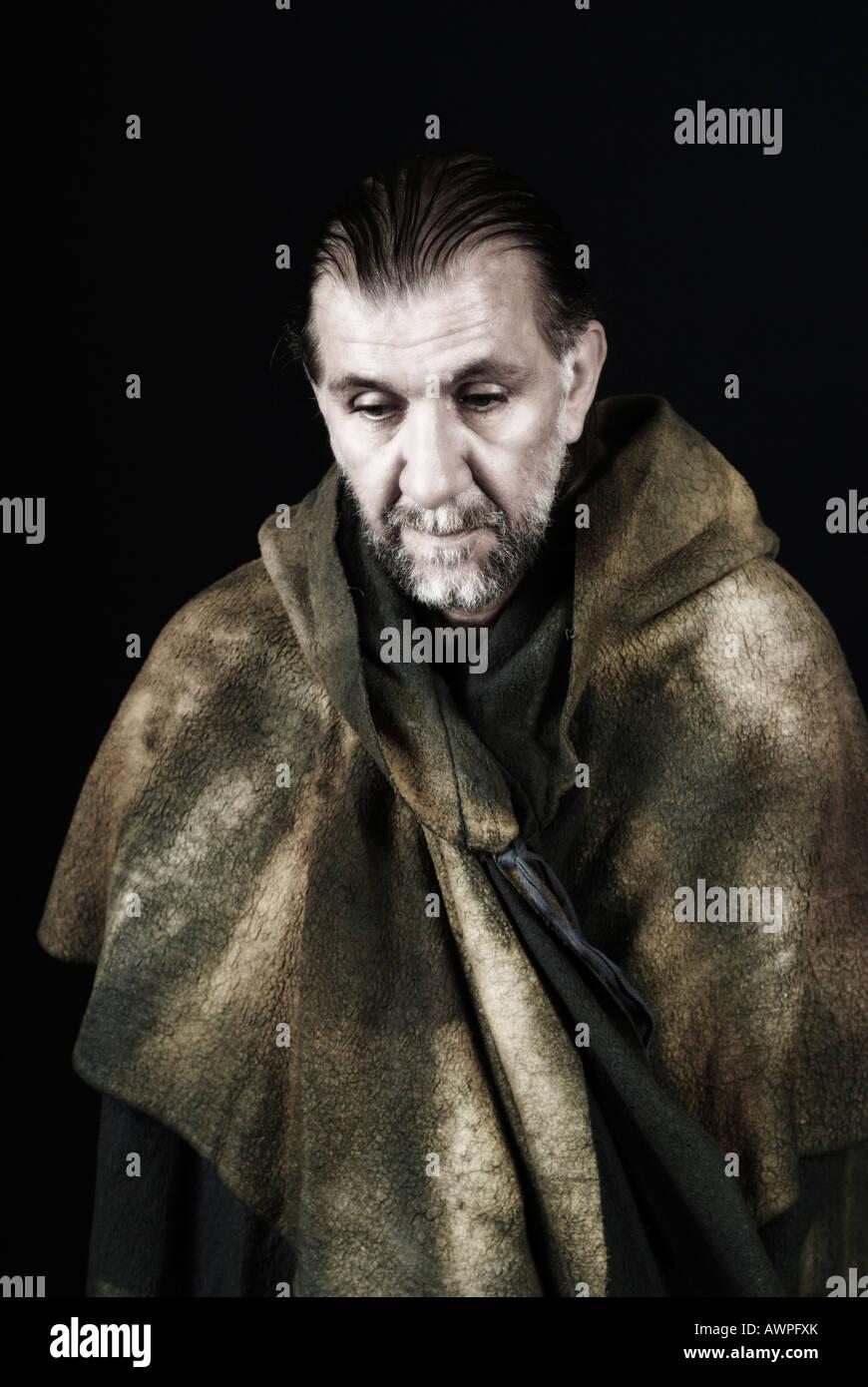 Monk wearing cloak Stock Photo