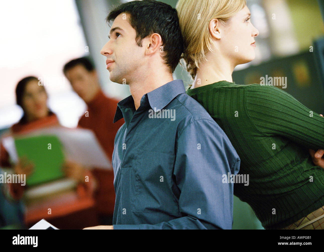 Businessman and woman back to back - Stock Image