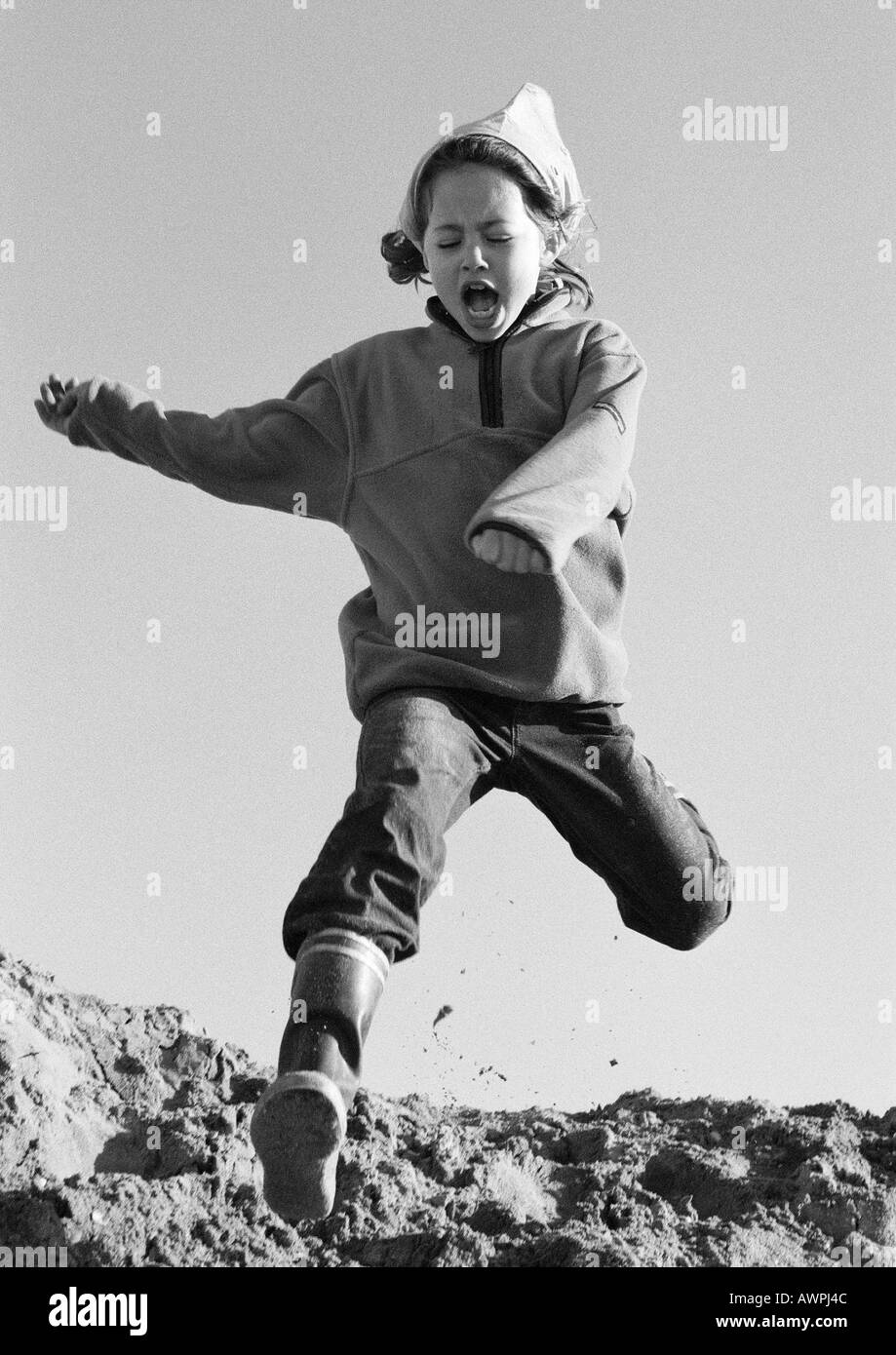 e35a0aa0 Little Girl Running Black and White Stock Photos & Images - Alamy