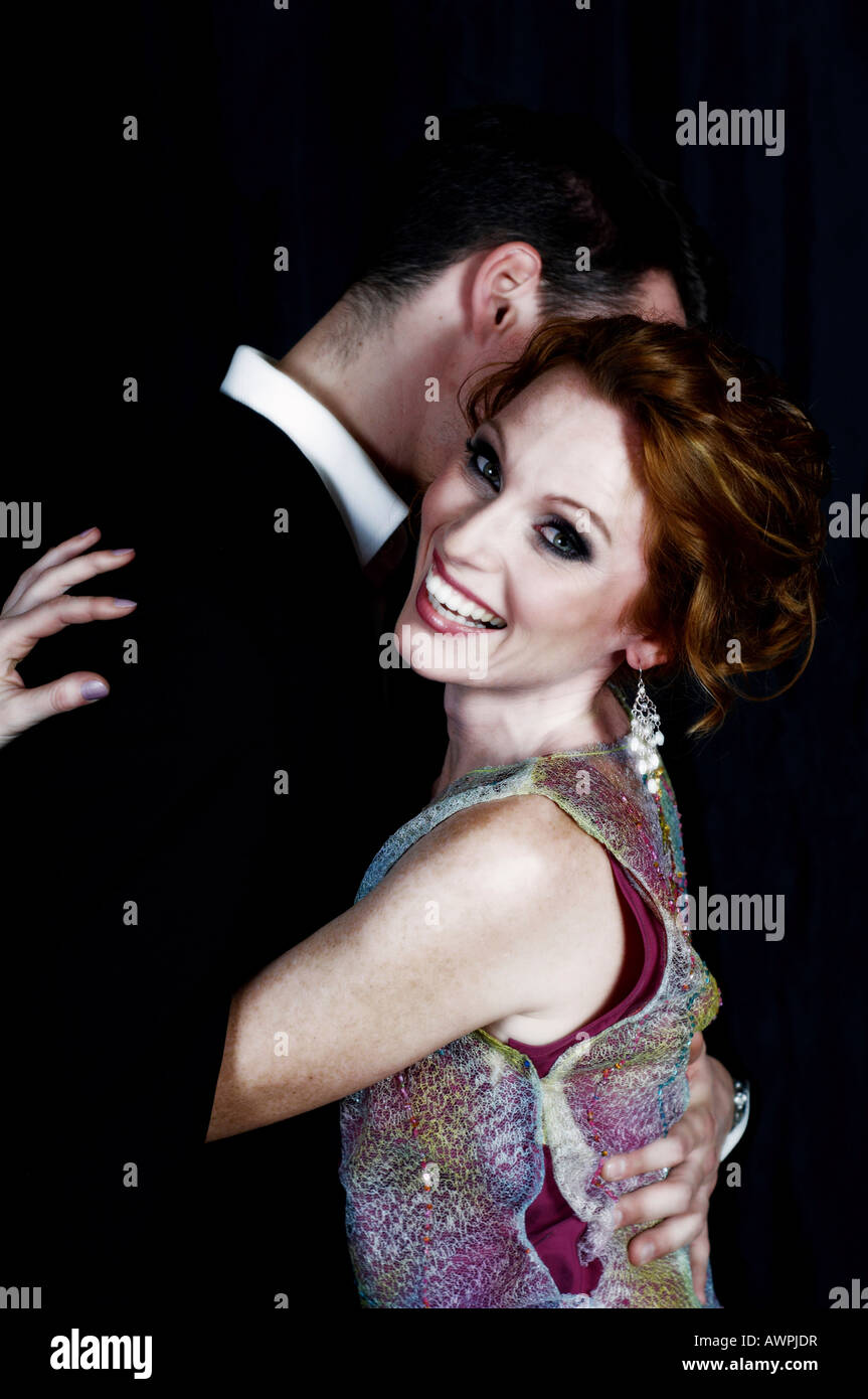 e60d336192c5 Young couple dressed in evening wear hugging Stock Photo: 16633282 ...