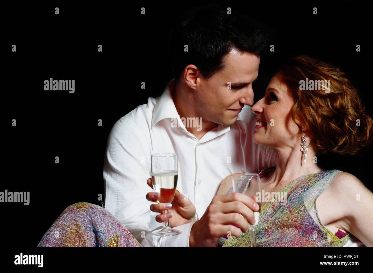 af3623a9fff0 Couple dressed in evening wear, cuddling Stock Photo: 16633319 - Alamy