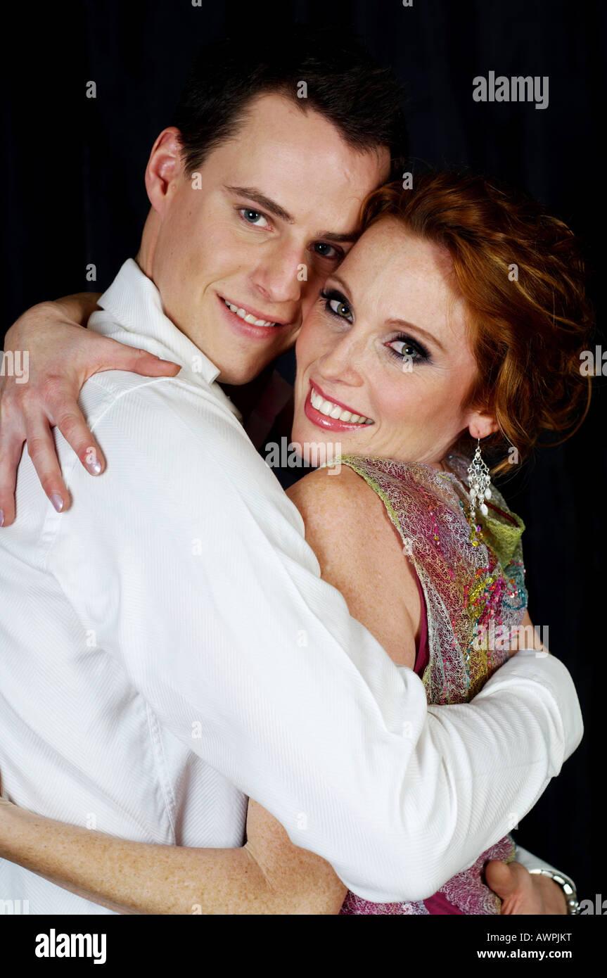 e09de849821a Couple dressed in evening wear, hugging Stock Photo: 16633355 - Alamy