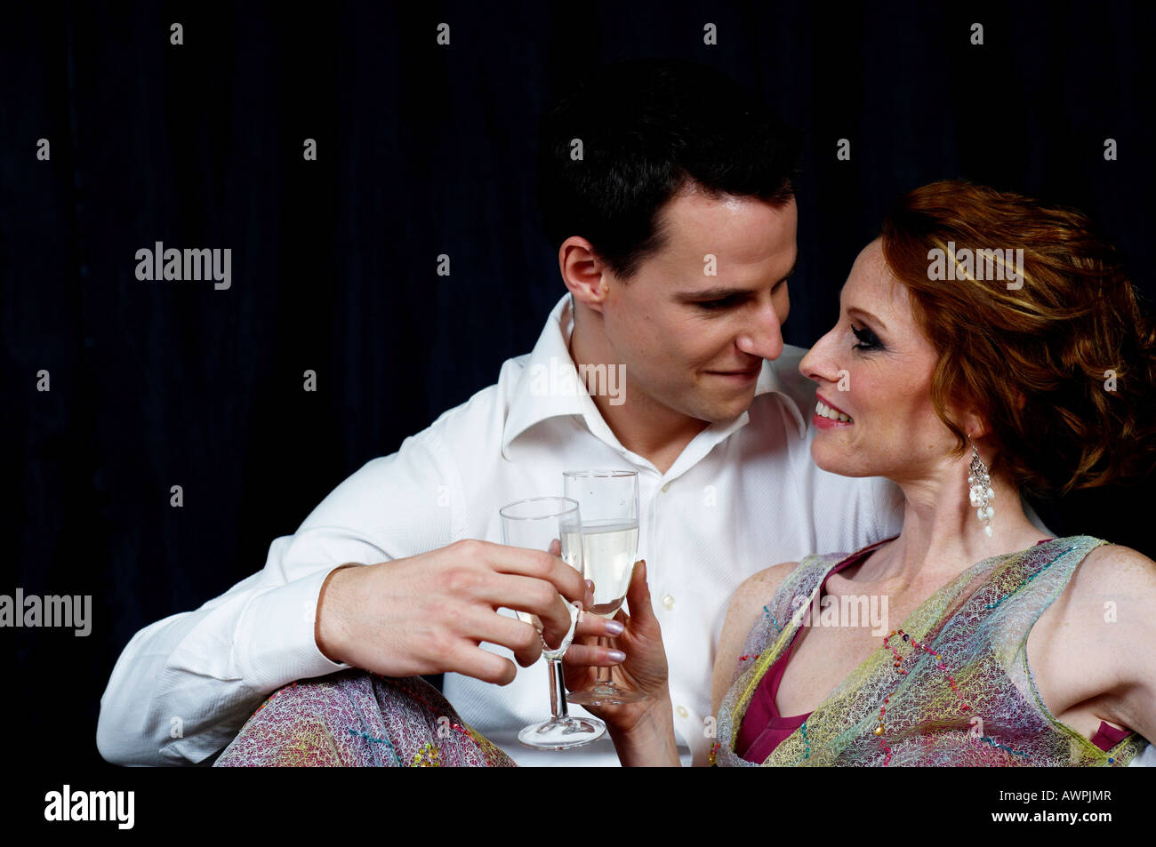9cef2856ef55 Couple dressed in evening wear, caressing one another Stock Photo ...