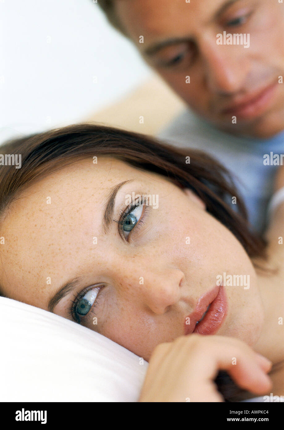 Couple in bed, close-up - Stock Image