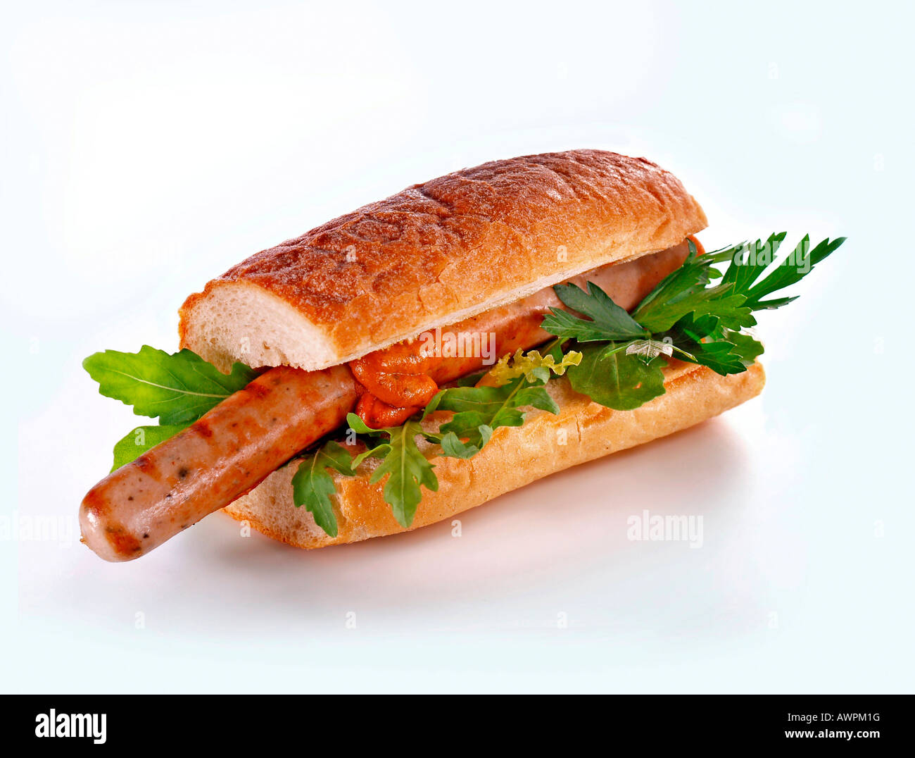 Thuringian-style bratwurst, mustard and lettuce on a baguette Stock Photo