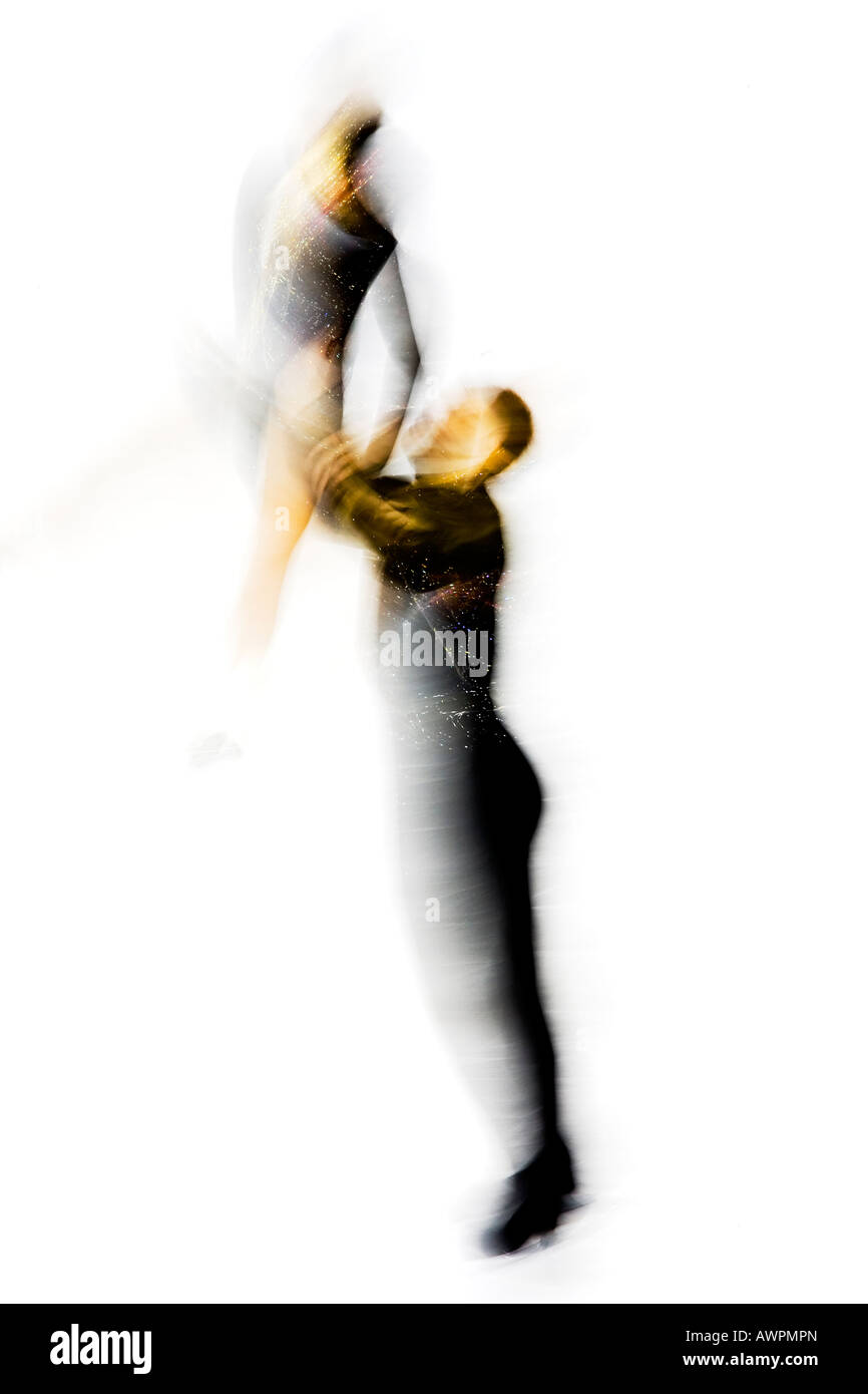 Blurred action of pairs figure skaters - Stock Image