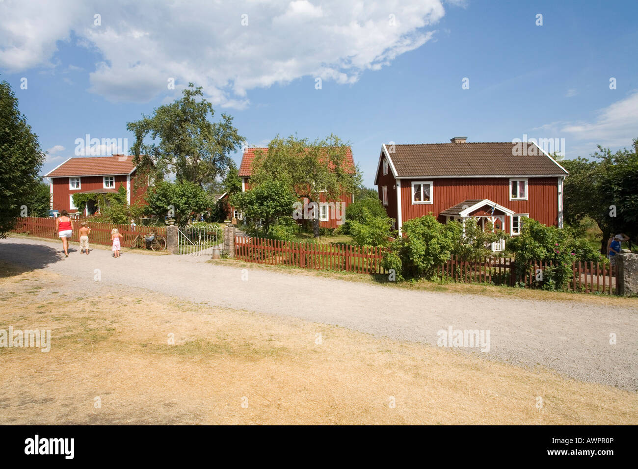 The three farms of Bullerby: North Farm, Middle Farm and South Farm as described in the Astrid Lindgren books, Sevedstorp, - Stock Image