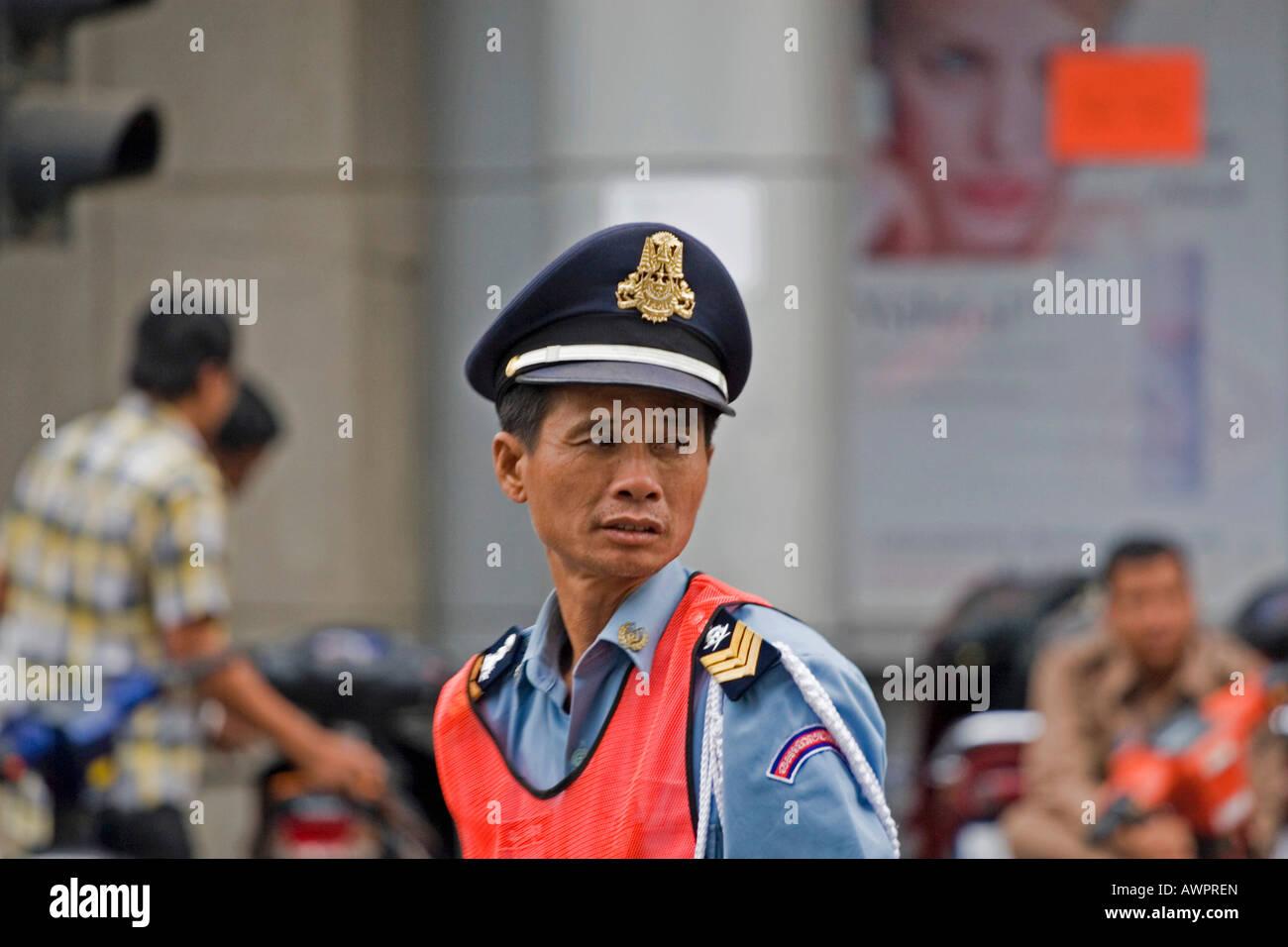 Policeman in Phnom Penh, Cambodia, Asia - Stock Image