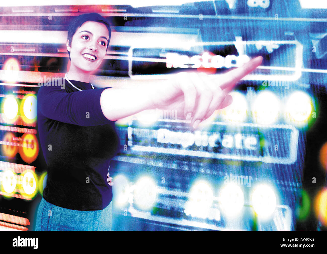 Young woman smiling in cyberspace, pointing, digital composite. - Stock Image