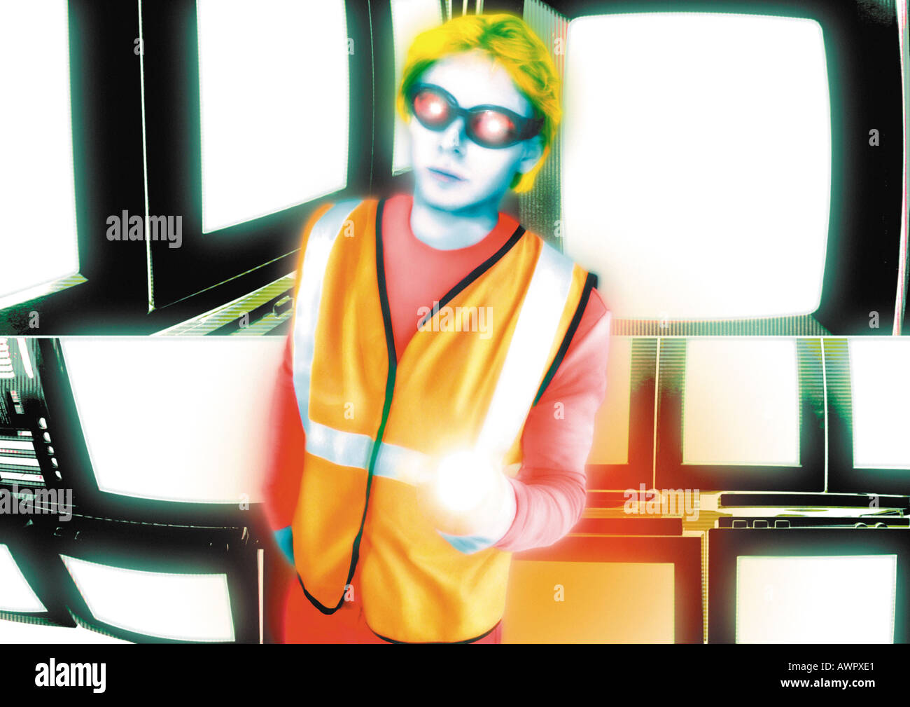 Young crossing guard standing in front of monitors, digital composite. - Stock Image
