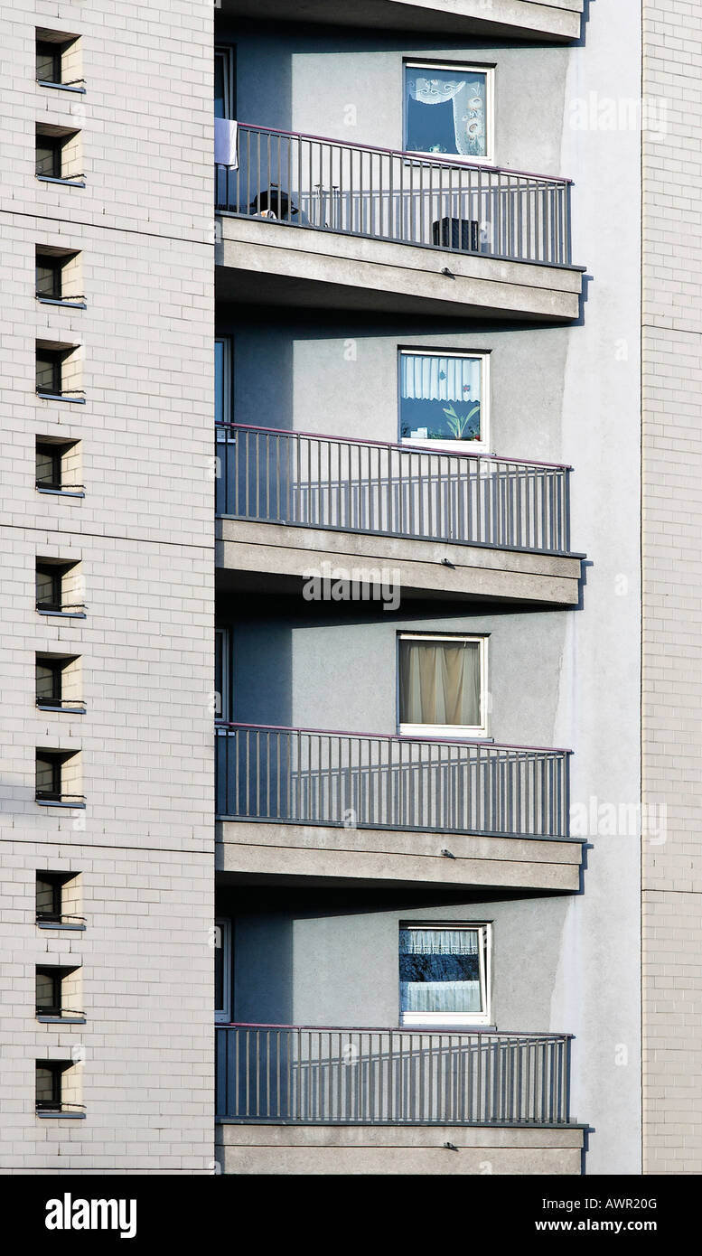 Monotone building facade with balconies, railings and small windows, Tempelhof, Berlin, Germany, Europe - Stock Image