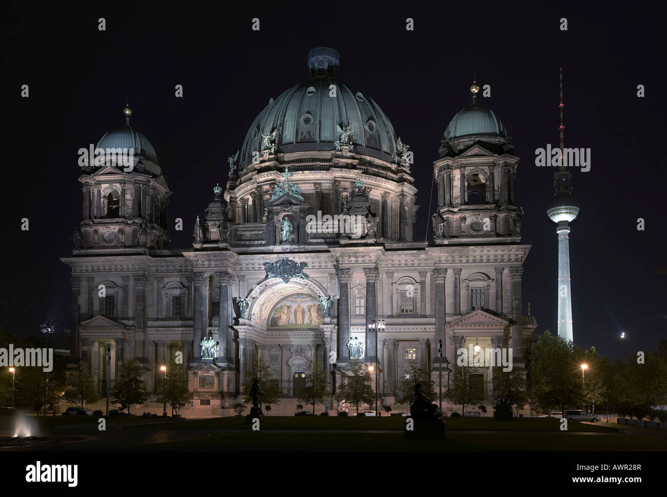 Nighttime view of Berlin Cathedral with TV tower in the background, Berlin, Germany, Europe - Stock Image