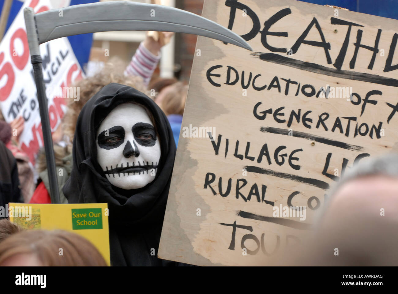 a person dressed as the grim reaper in a costume during a demonstration rally rallies to protest aginst the governments - Stock Image