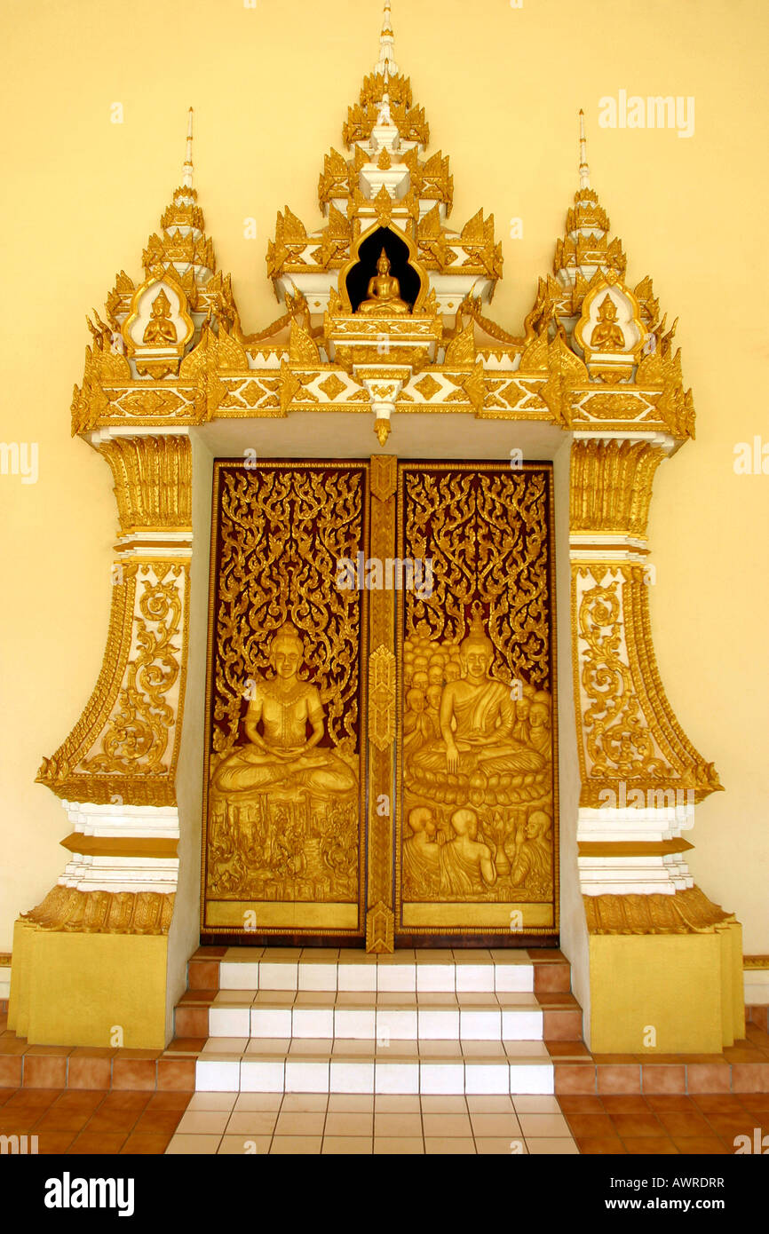 Laos Vientiane Wat That Fun carved wooden doorway with decorative surround Stock Photo