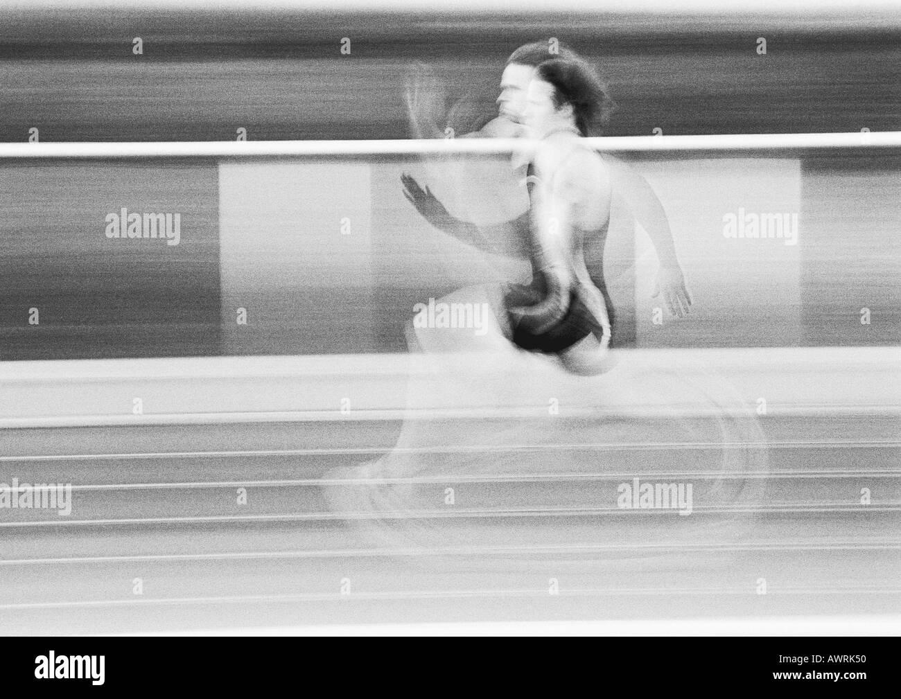 Male athlete running fast, blurred motion, b&w Stock Photo