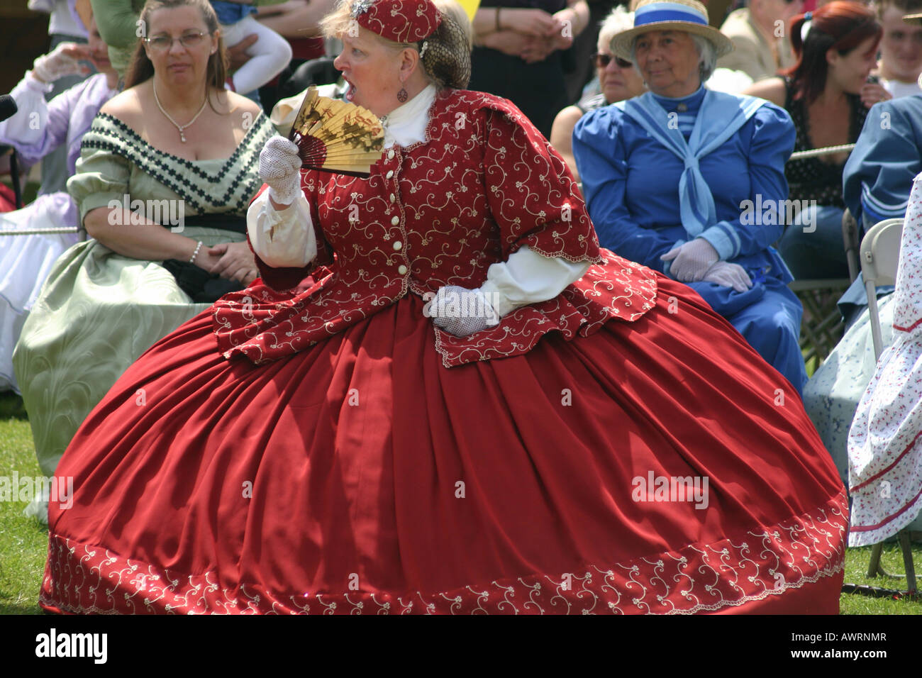 victorian lady street theatre actress large red dress   dickens festival - Stock Image
