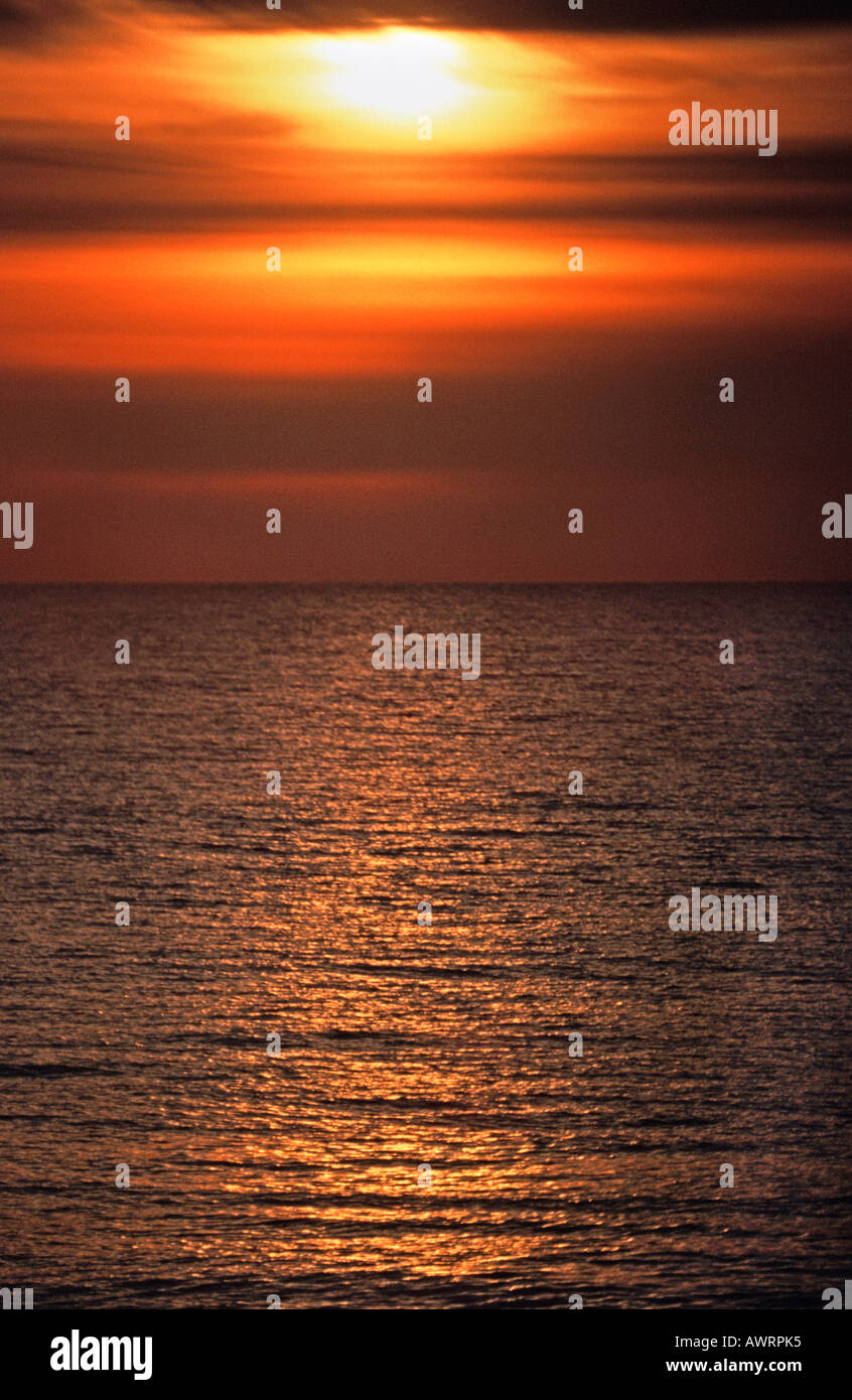 Sun setting over the English Channel Brighton East Sussex England - Stock Image