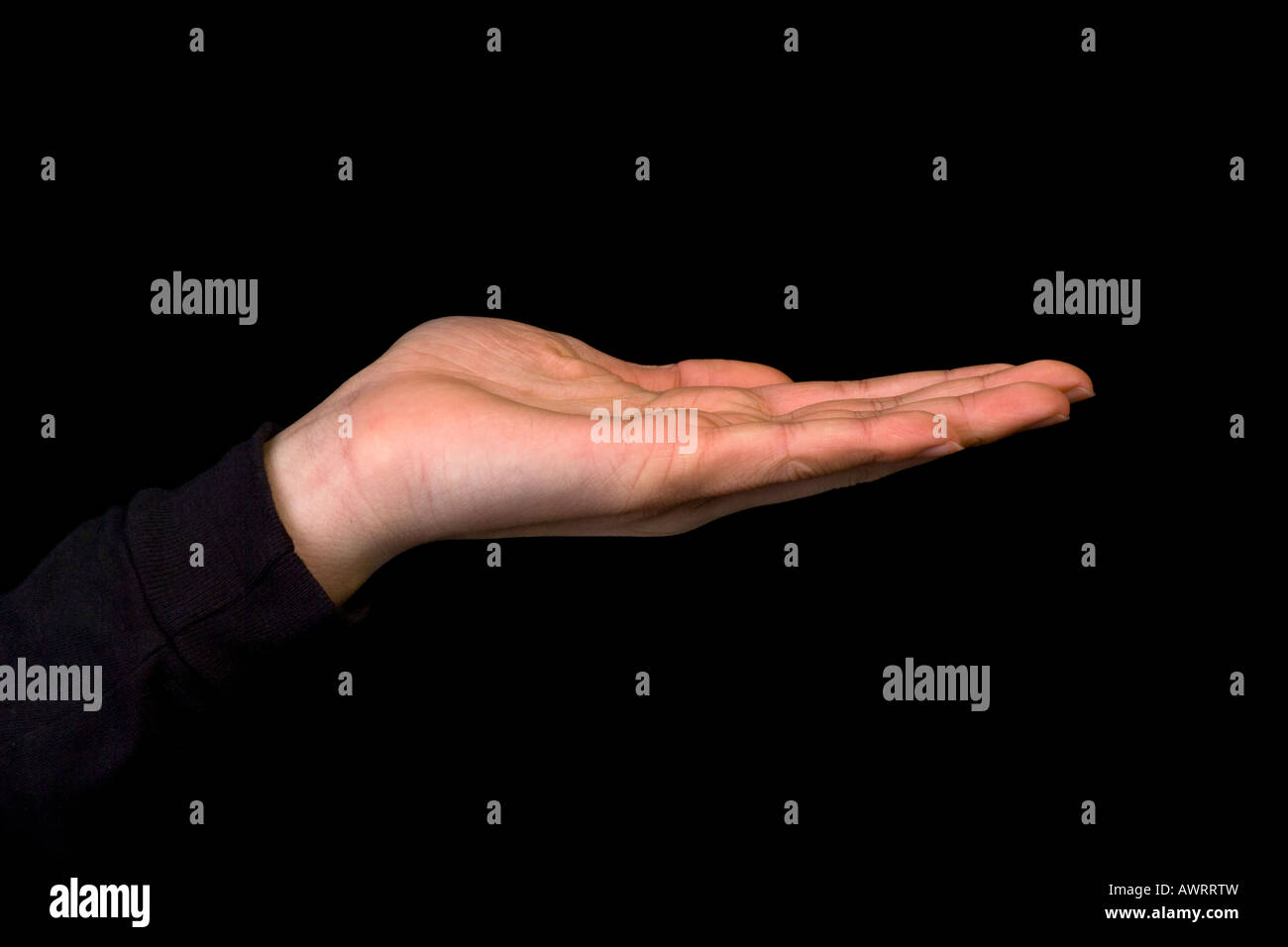 left hand palm up - Stock Image