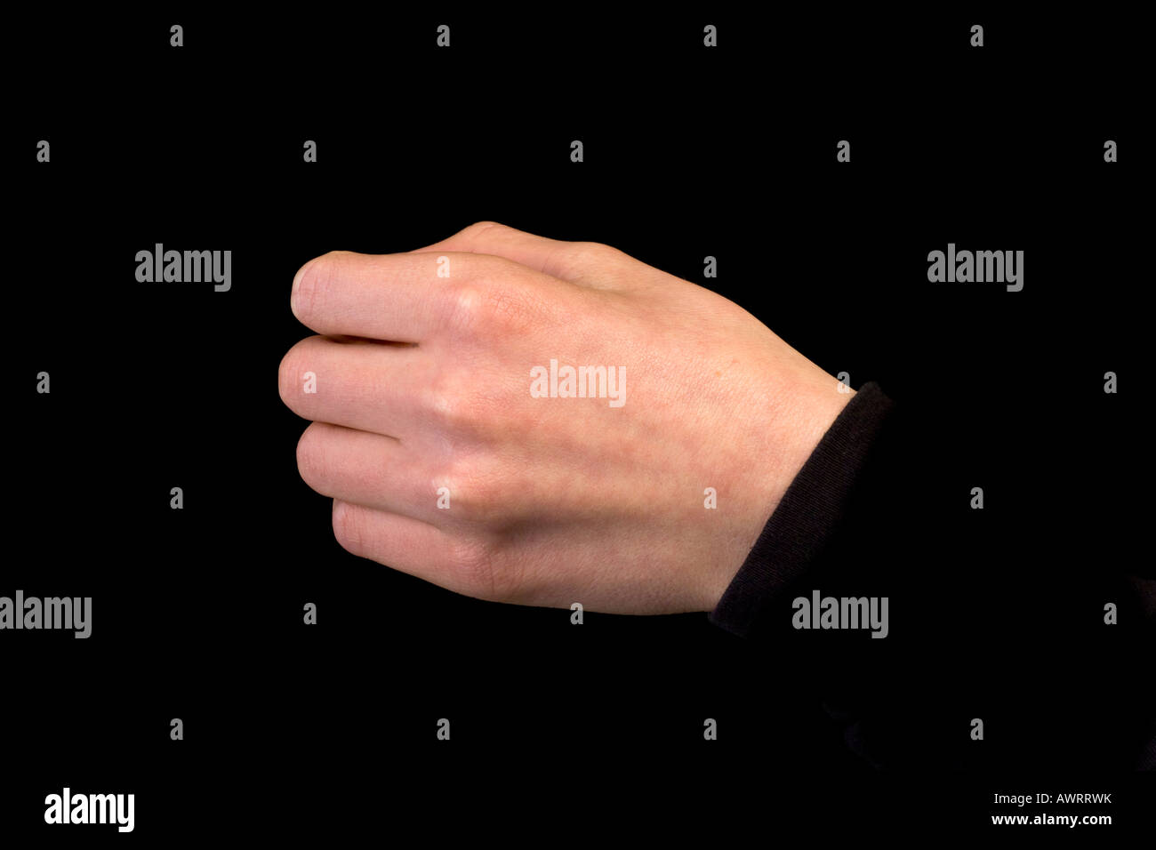 left hand gripping - Stock Image