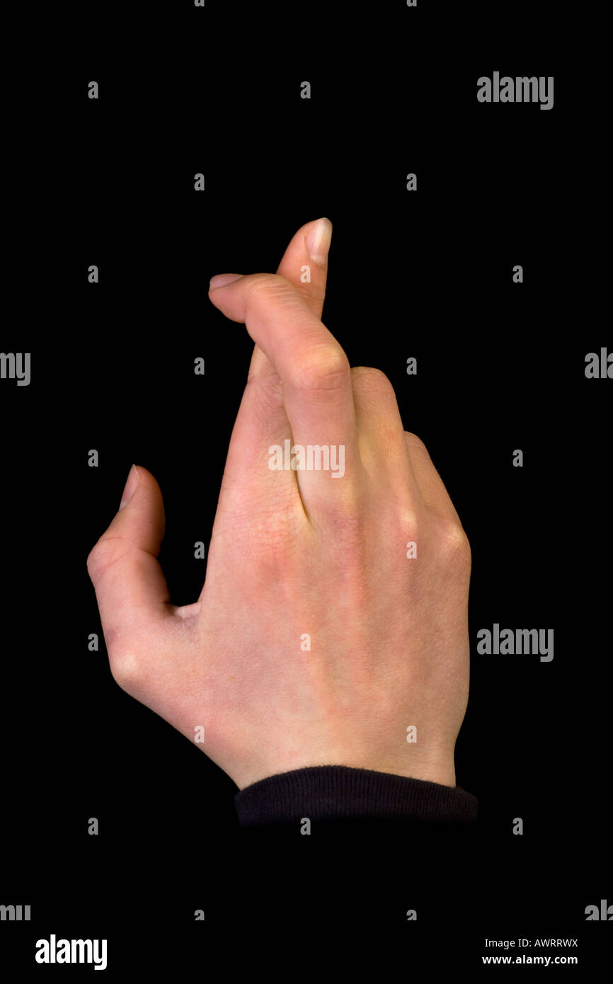 right hand fingers crossed for good luck - Stock Image