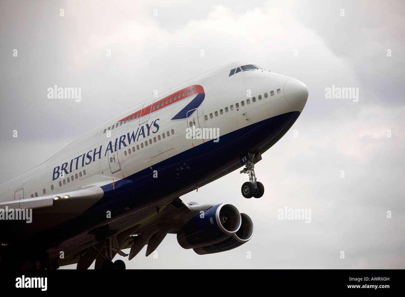A British Airways Boeing Jumbo Jet takes off at London Heathrow Airport - Stock Image
