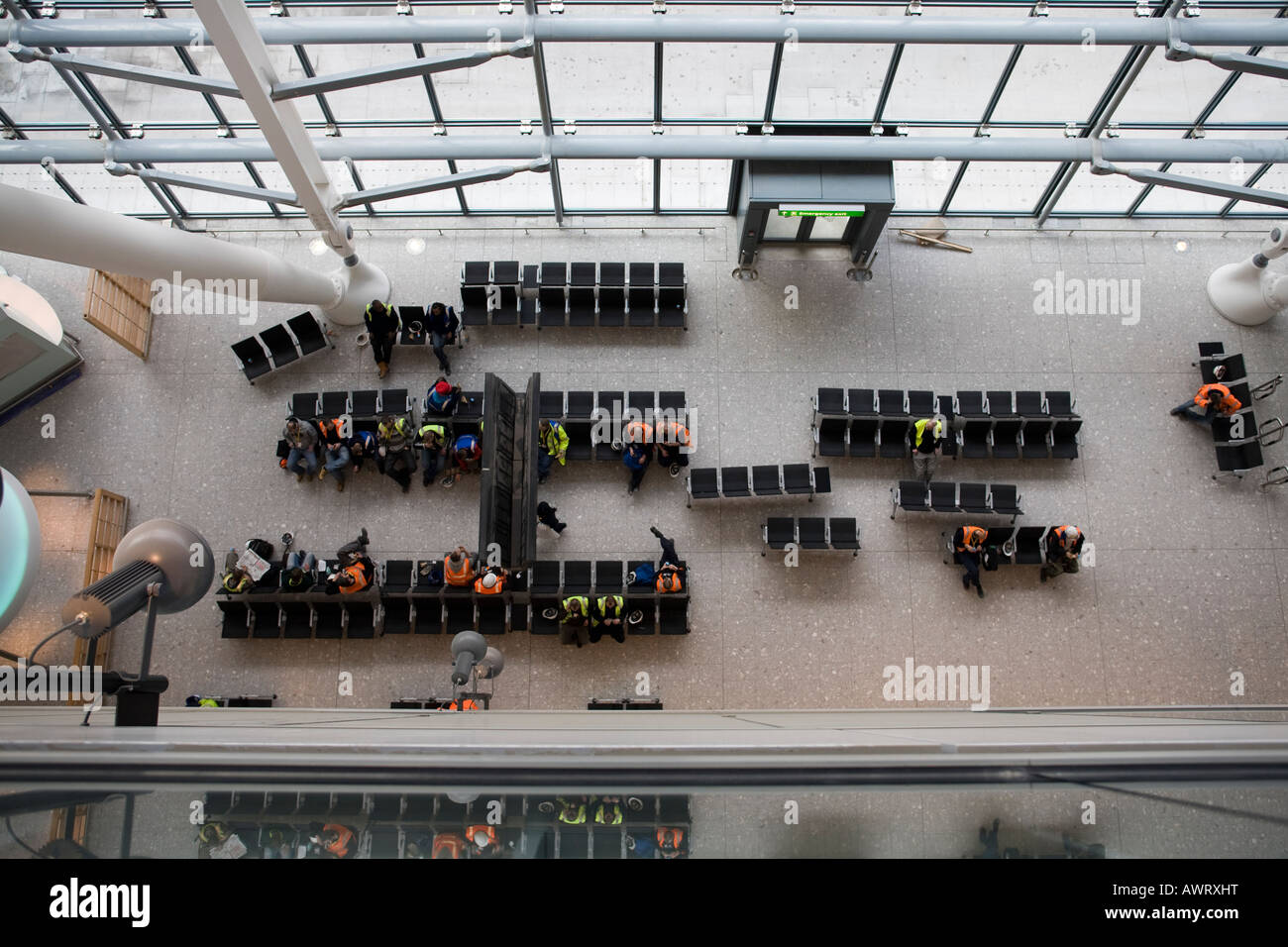 construction workers take a break at London Heathrow Airport terminal 5 - Stock Image
