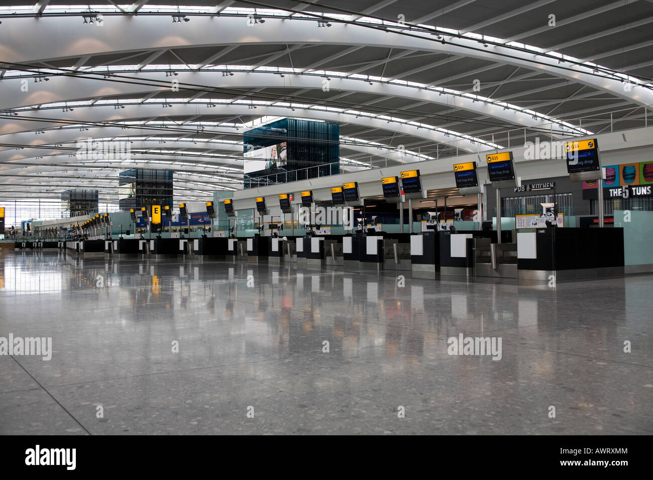 British Airways fast bag Drop Check in desks at London Heathrow Airport Terminal 5 - Stock Image