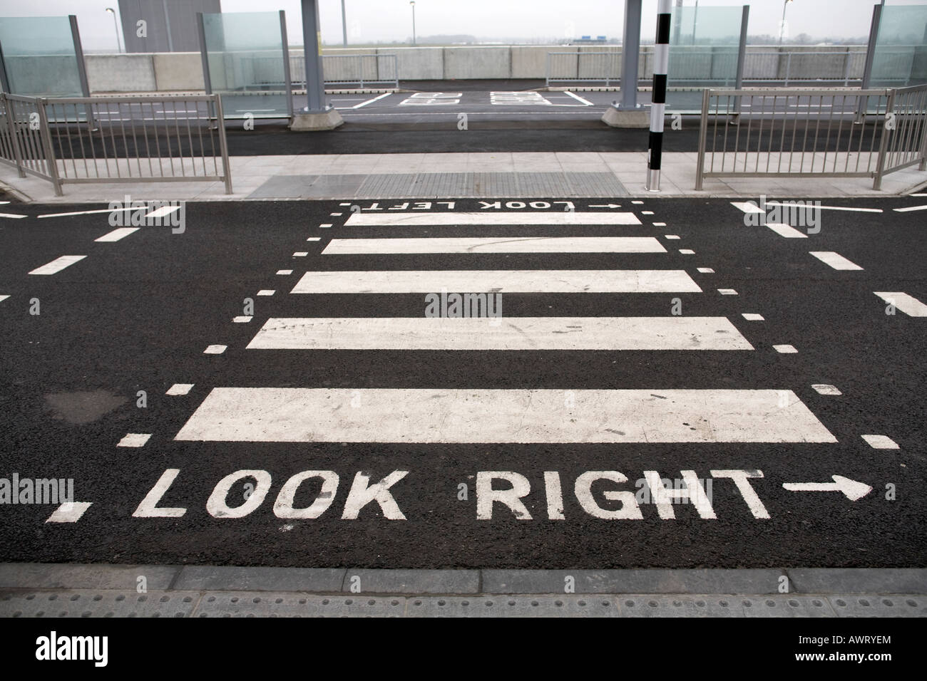 A pedestrian crossing point outside London Heathrow Airport Terminal 5 Stock Photo