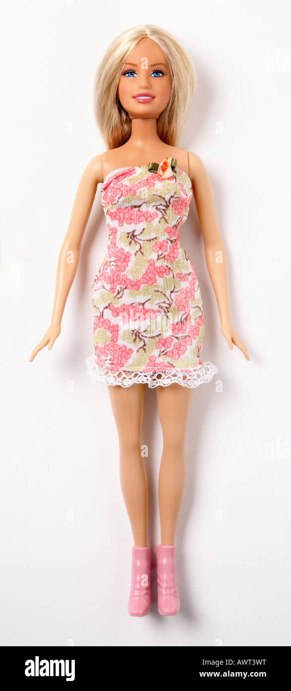 Barbie doll on white background wearing a pink dress - Stock Image