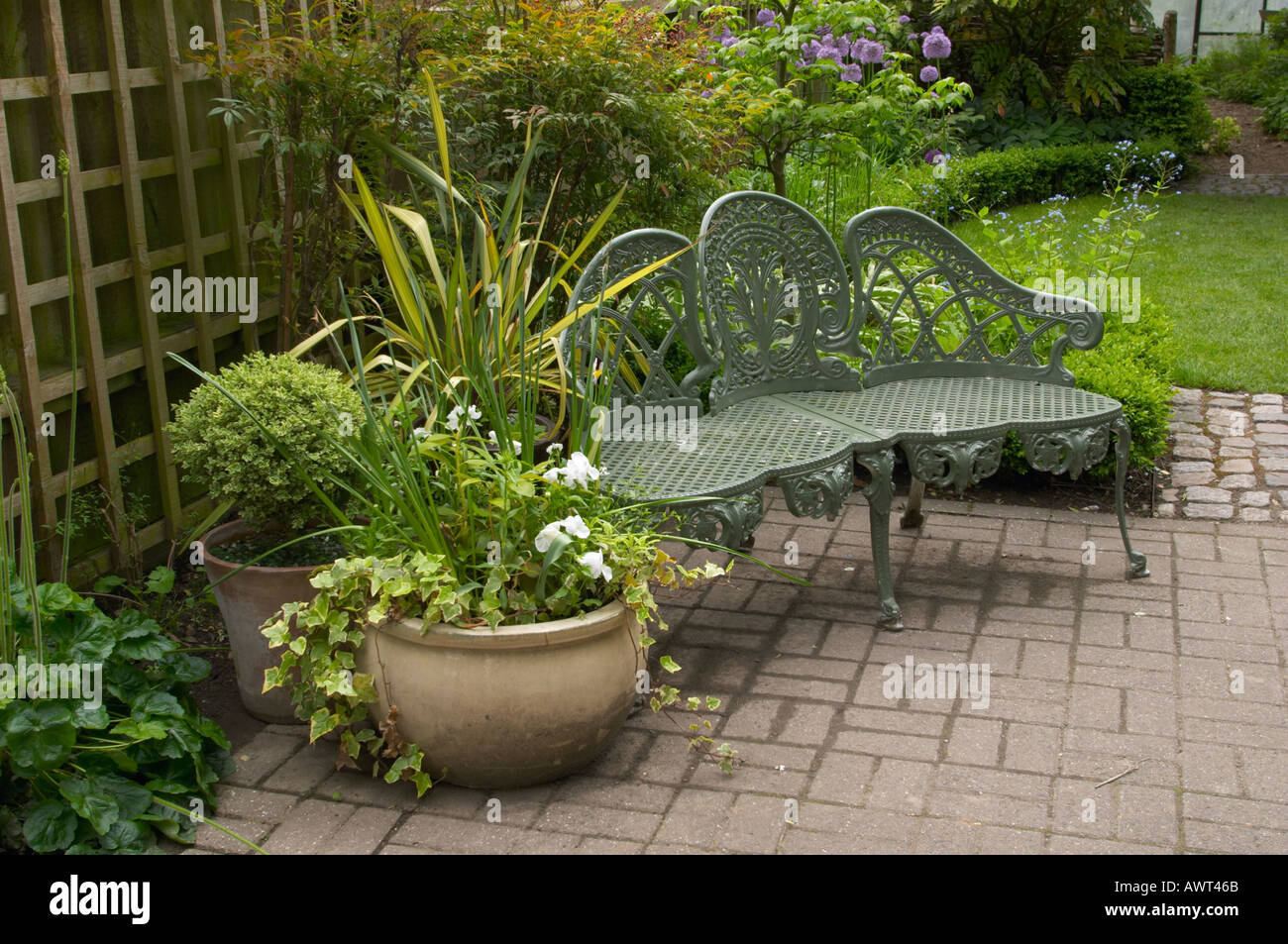 Green Painted Metal Bench On Garden Patio Stock Photo Alamy