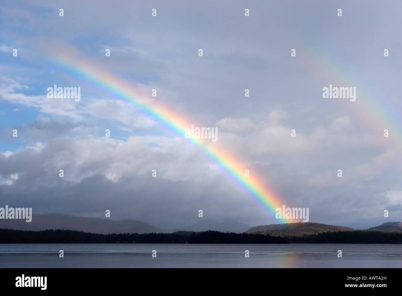Rainbow over Lake Sacandaga, Adirondack Mountains, New York - Stock Image