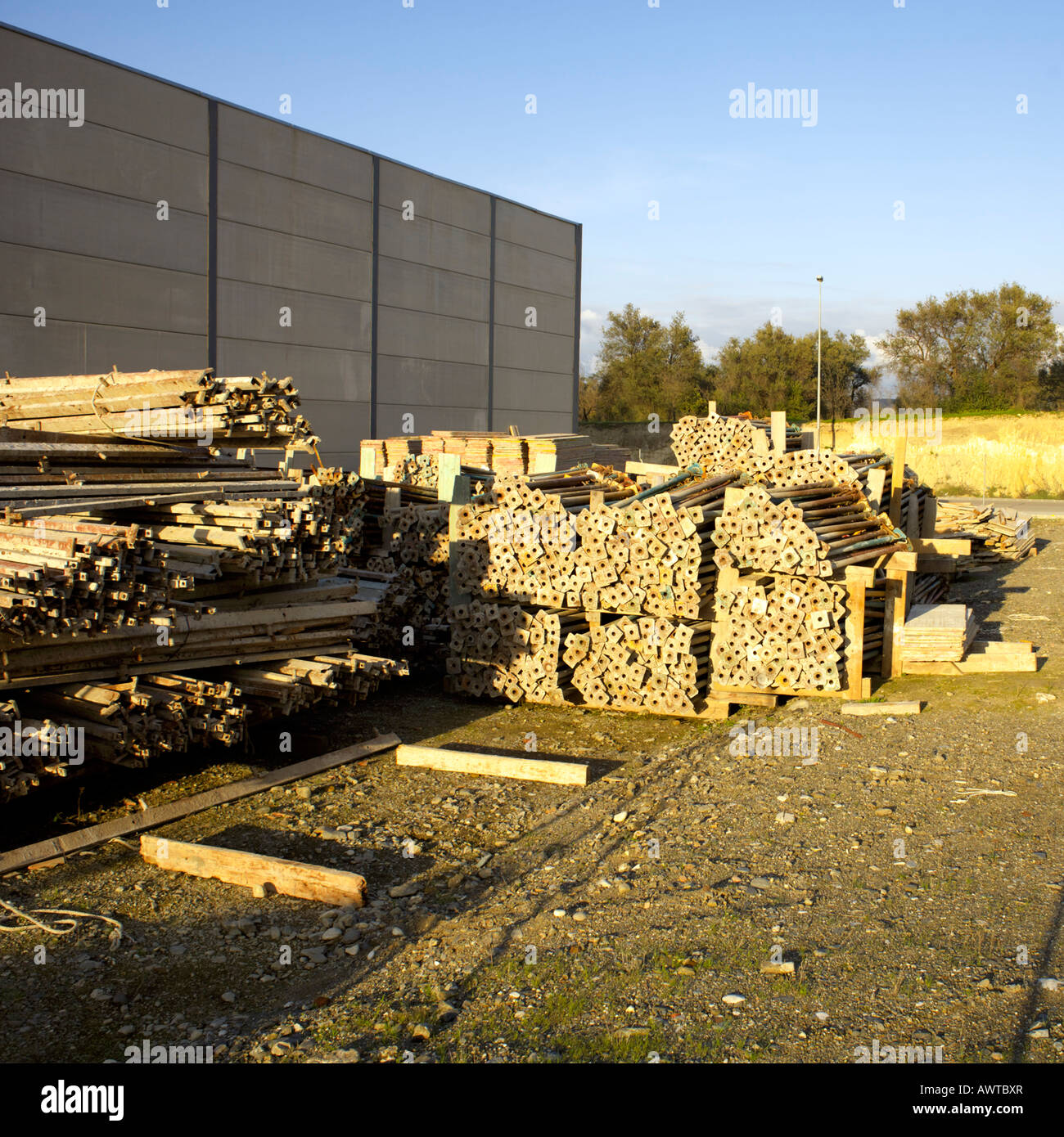 Stack of building builders props Acrow Props acro accrow supports - Stock Image