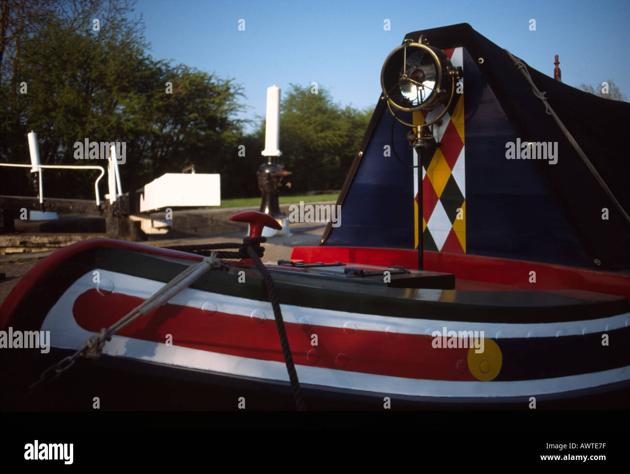 PICTURE CREDIT DOUG BLANE Traditional narrowboat with canal lock in background Grand Union Junction CanalStock Photo