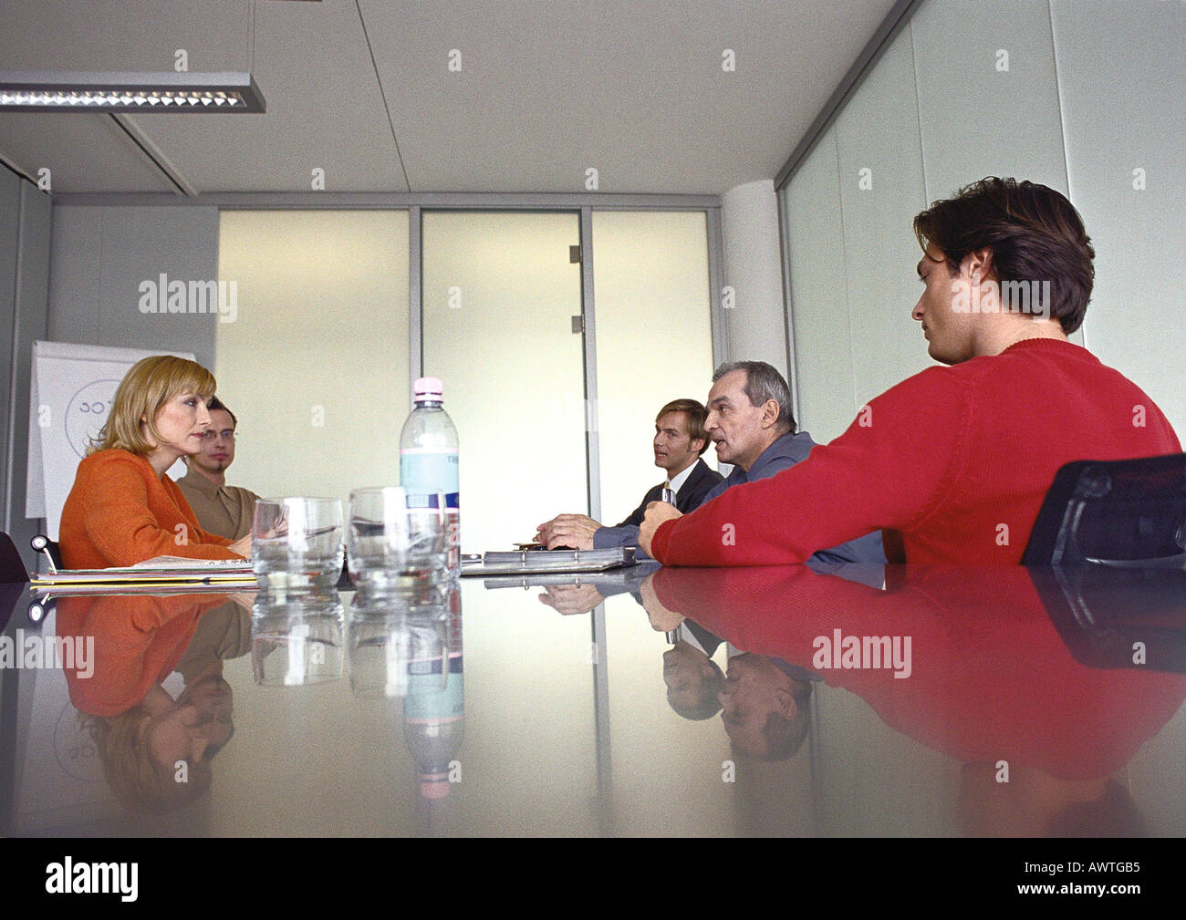 Business people sitting at table in meeting  room. Stock Photo