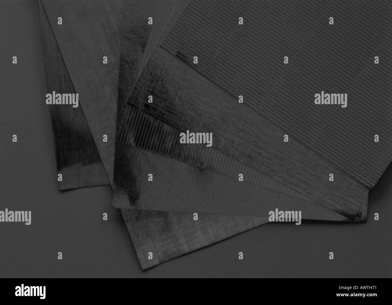 Sheets of paper, close-up, solarized - Stock Image