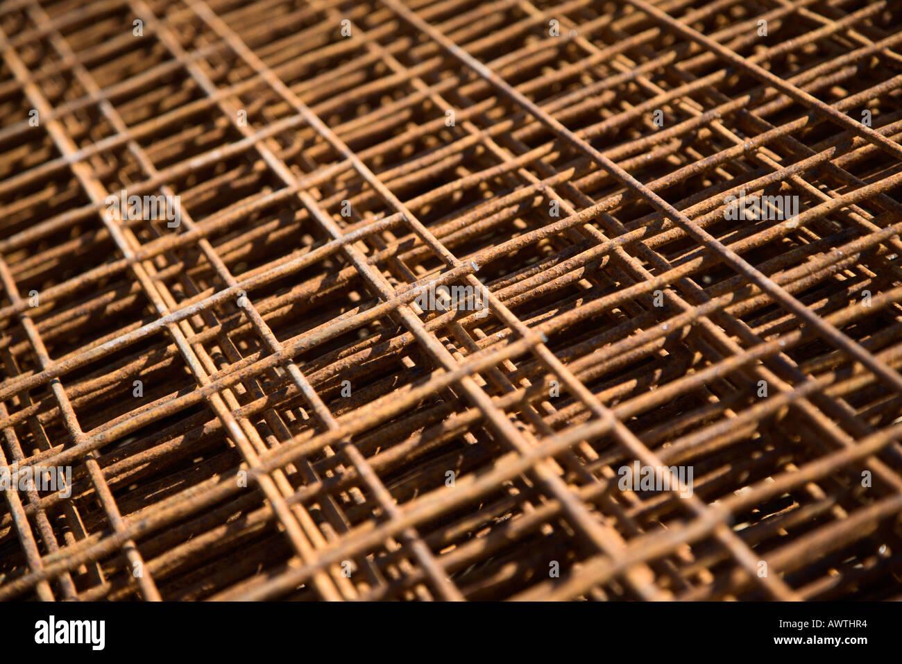 Rusty steel mesh forms rectangular patterns - Stock Image