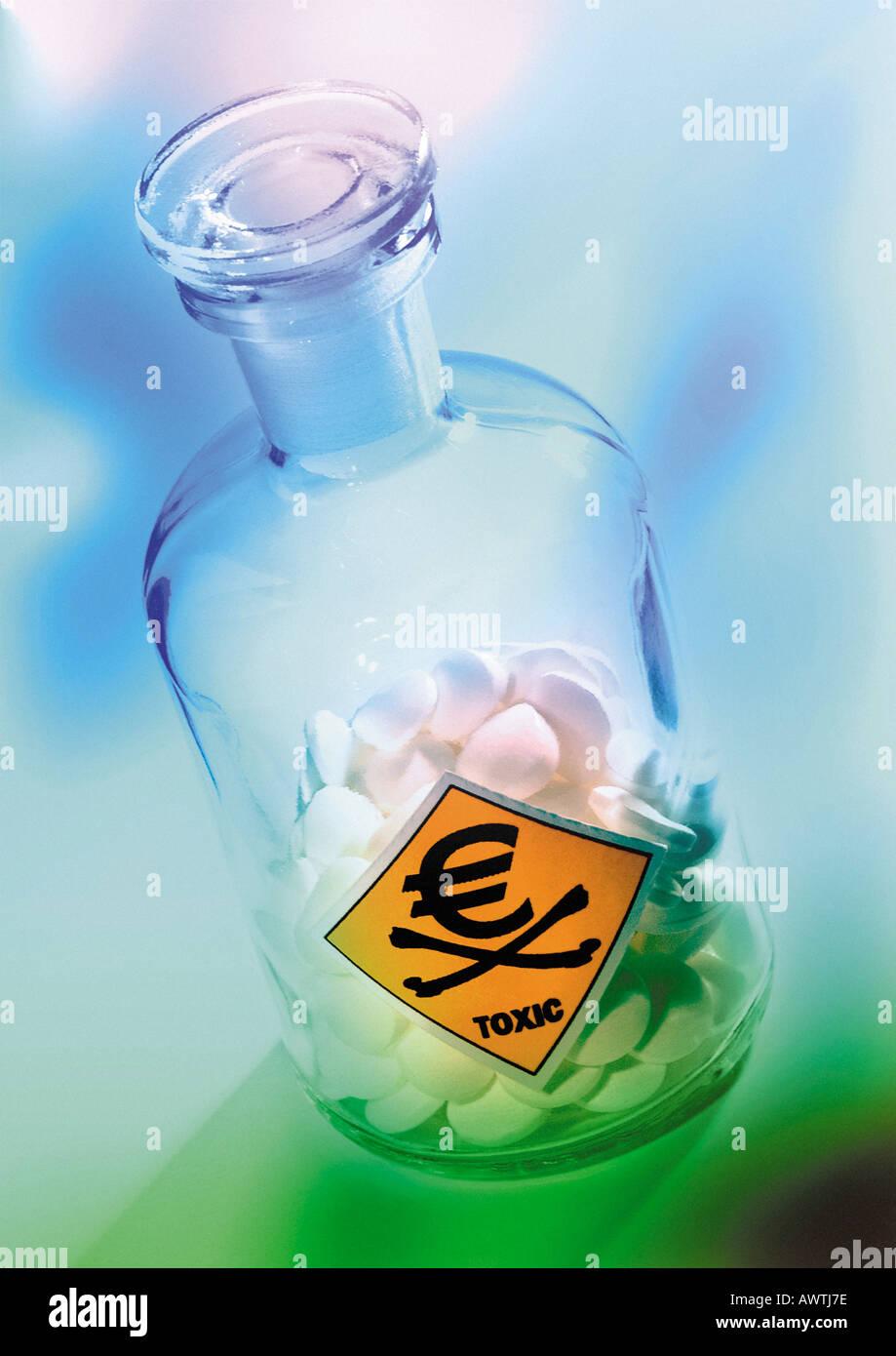 Euro sign on poison bottle. - Stock Image